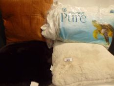 3 Large sized pillows plus 2 bedding pillows