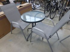 Round glass top patio table and 2 chairs