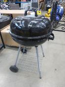 Round charcoal barbecue on stand