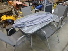 Glass rectangular garden table, 4 matching chairs and a parasol