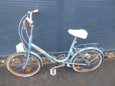 Blue vintage ladies fold up bike and a pink vintage shopper
