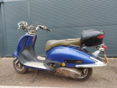 Blue Tamoretti petrol powered scooter complete with log book and key, covered 38,000 miles