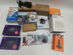 Bag containing Fire TV Stick 4K, BT 4G Assures, HP wireless mouse, Logitech webcam, LED projector,