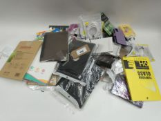Bag containing various mobile phone accessories; cases, covers, cables, earphones, stands etc