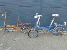 2 vintage bicycles, 1 blue and 1 orange