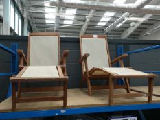 2 beige and wooden sun loungers