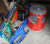 Half an underbay containing extension cable, 2 strimmers and an elephant step up stool