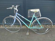 Green and purple Raleigh ladies bike
