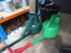 Plastic bucket and 2 watering cans