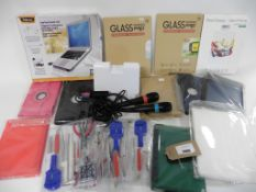 bag of Tablet cases & covers, laptop stand, tablet stand, pair Singstar microphones and 3 small tool