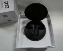 LG Tone Free UV Nano wireless earbuds with charging case and box