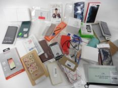 A bag of assorted smart phone cases, charging pads, cables, Car Vent mount, monopod and multi