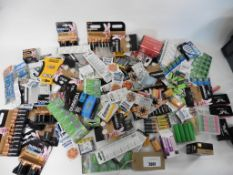 A bag of assorted batteries, AA, AAA, 9V, button, etc.