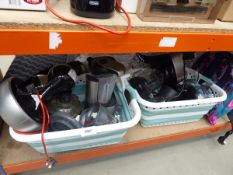 Two laundry baskets containing mixed kitchen equipment including coffee machines, food processors