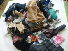 Stillage containing mixed ladies and men's clothing (approximately 85 items)