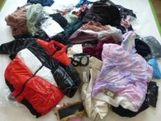 Stillage containing mixed ladies and men's clothing (approximately 90 items)