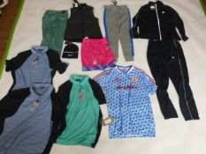Selection of sportswear to include Nike, Brick Fielder, Adidas, etc
