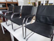 Four black leather effect and chrome frame cantilever chairs