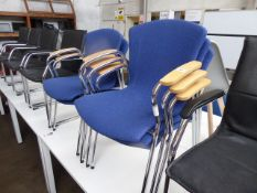 Five chrome frame blue cloth stacking chairs