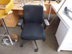 Black swivel armchair