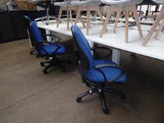 Six blue cloth swivel arm chairs