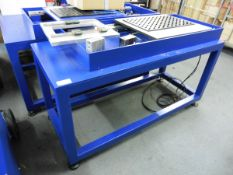 2 blue welded specialist workbenches, one 1.42m x 0.85m x ~0.8m high on adjustable feet (not