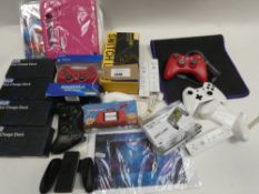 Bag containing quantity of gaming accessories; controllers, handheld game consoles, charging