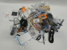 Bag containing quantity of various mobile phone accessories; cables, chargers, earphones, holders,