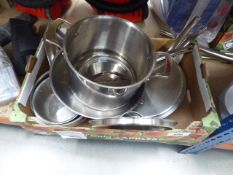 Tray containing stainless steel pots and pans, used