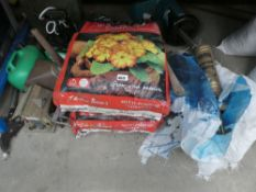 Multi purpose compost, Roundup, fuel cans and a bird house