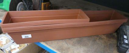 3 plastic terracotta coloured troughs