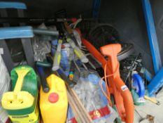 Half underbay containing garden tools, forks, parasol base, hanging baskets, compost, slate