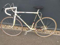 Raleigh yellow and white racing bike