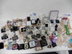 Bag of assorted dress jewellery, necklaces, keyrings, rings, bracelets, etc