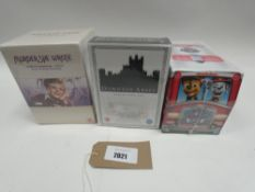 Bag containing 3 sealed boxsets; Murder She Wrote, Paw Patrol and Downton Abbey