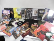 Bag of records about 22 LP vinyl albums and about 11 singles inc Iron Maiden, Blondie, Harry