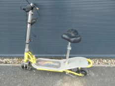 Yellow and silver electric scooter
