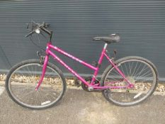 An Apollo Pulse cerise girls mountain bike