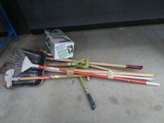 Underbay of assorted tools incl. spades, brushes, garden kneeler, edger, etc.