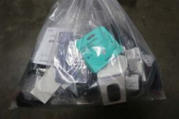 Bag containing electrical related accessories; remotes, keyboard, router, PC mice, etc