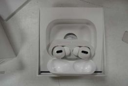Pair of Apple AirPods Pro with wireless charging case and box