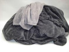 Bag containing 2 large grey throws, 1 in light grey, 1 in dark grey