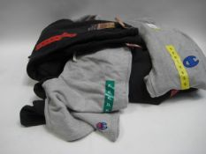 Bag containing 9 pairs of jogging bottoms by Champion, Weatherproof, DKNY, etc sizes ranging from