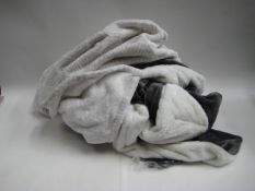 Bag containing 2 throws, 1 grey and cream and cream with grey diamond pattern
