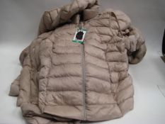 Bag containing 8 32 Degree Heat ladies quilted hooded gilets in 'goat cream'