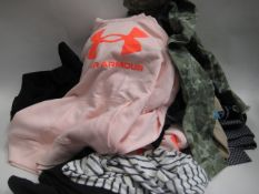 Bag containing ladies clothing to include 2 Under Armour hoodies in pink and light blue, camo jacket