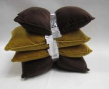 4 small rectangular pillows, 2 in dark brown and 2 in mustard colour