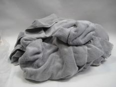 Bag containing various sized Calvin Klein grey towels, some with tags