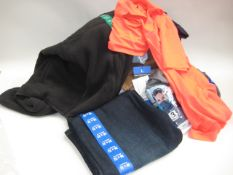 Bag containing gents clothing to include Under Armour polo shirts, jeans by Weatherproof,
