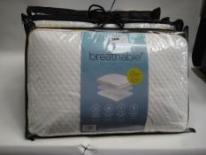Four bagged Snuggle Down breathable memory foam pillows